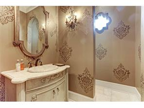 Captivating downstairs powder room divinely appointed with Segreto stenciling.