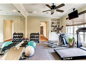 Upstairs exercise room. A large, climate controlled, floored and shelved attic is contiguous with this room.