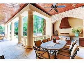Rich, massive columns anchor the resort-style patio. Hardwood ceiling and impressive stone work adorn the area. The summer kitchen and patio are climate controlled.