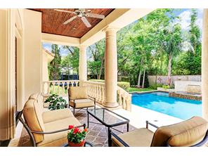 Loggia overlooking beautiful grounds and pool.