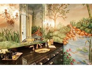 A hand painted mural of a flowing lily pond engulfs you in the formal powder room