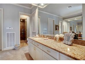 The master bath has a steam shower, numerous closets, a very large jetted tub and private his and her water closets