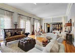 Gorgeous hardwood floors complete the ample sized formal living room