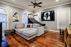 GAME ROOM with hardwood floors and plenty of room for comfy couches, TV and games.