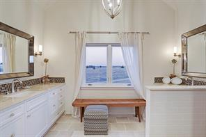 Master bath with separate sinks and vanities.