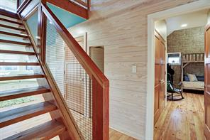 Stairs lead to 3rd floor office. Hidden door into secret hide out and hall leads to playroom.