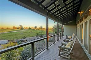 Front porch with plenty of space for all of your rockers.