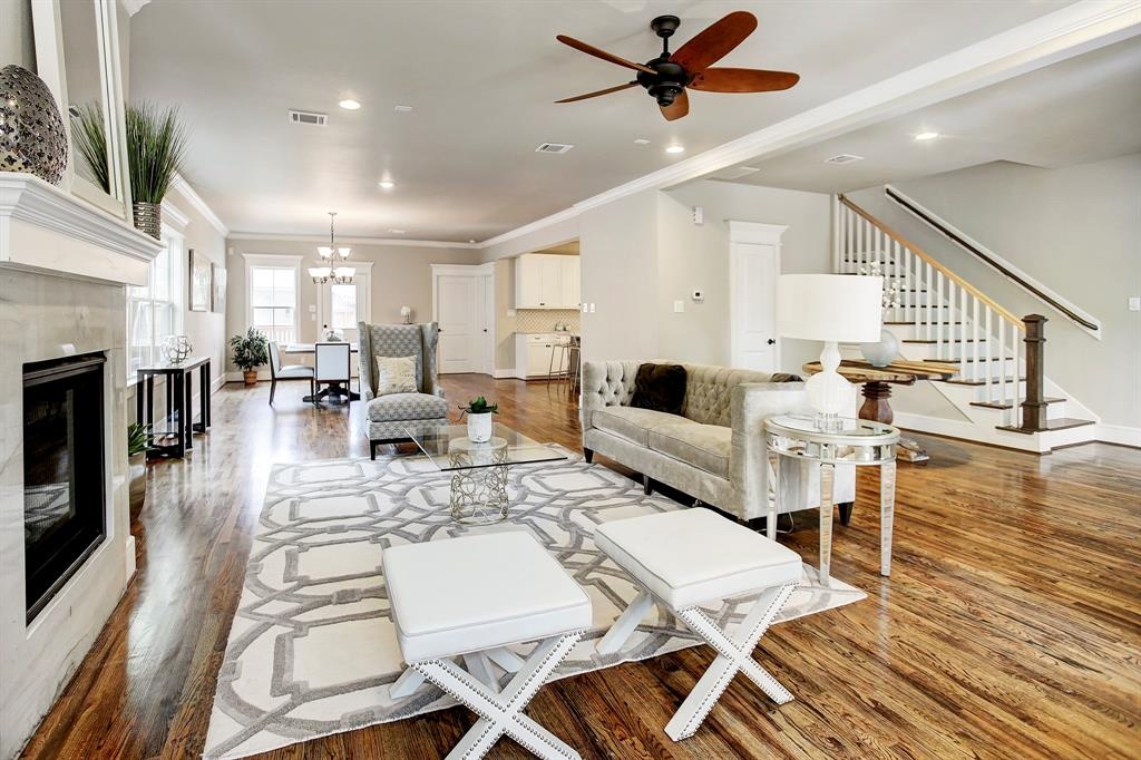 Best deal in the Heights! 4 bed, 3.5 bath home w/open living area, high ceilings, luxurious quartz counter tops, and gourmet kitchen. Classic crown molding & wood floors throughout. Large master bedroom w/sitting area & walk-in closet through the master bath. Large guest suite downstairs with full bath. Quaint facade accented by large front porch & shutters around the front windows. Ample storage & detached garage. Fireplace, laundry room & back patio round out this magnificent new construction home.