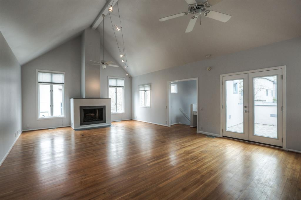 The open floor plan features a vaulted ceiling, lots of natural light and hardwood floors. Fresh interior paint throughout.