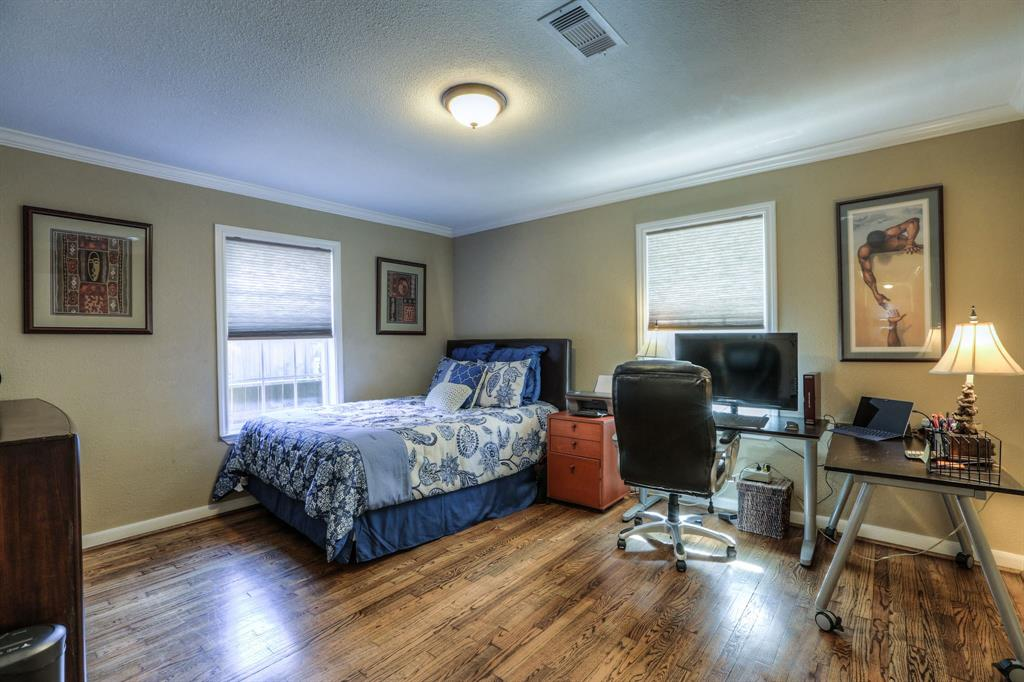 Bedroom # 2 with hardwood floors and crown molding.  Excellent closet space in the secondary bedrooms.