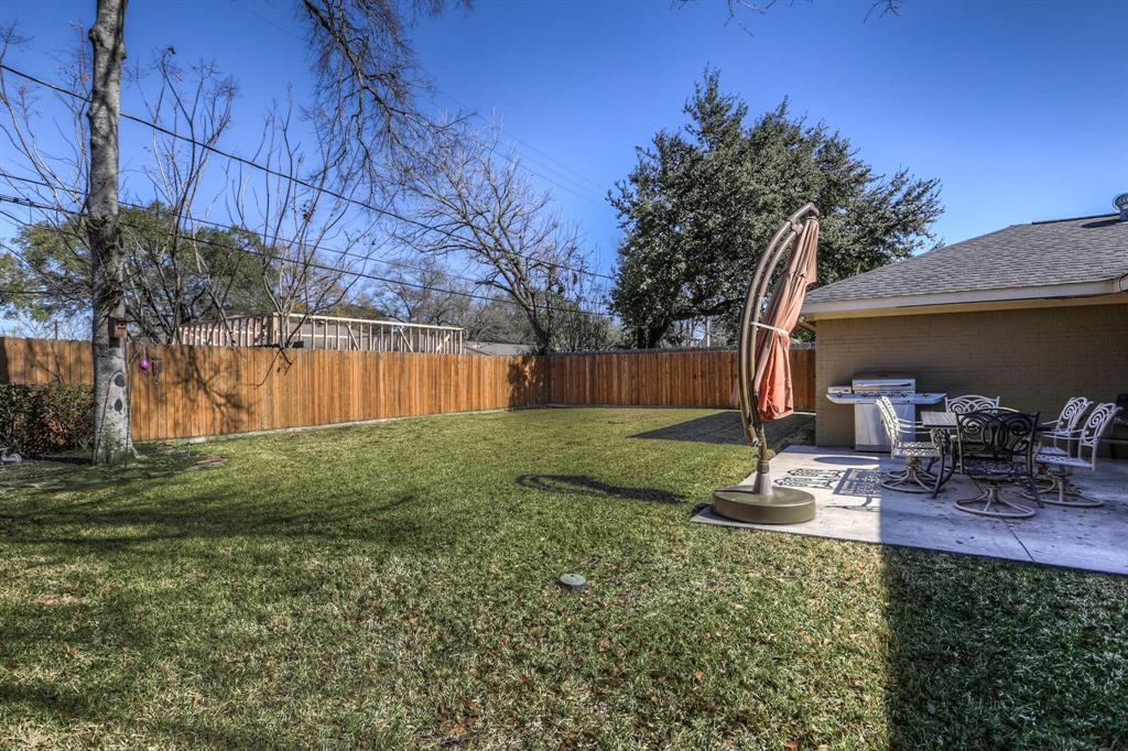 Large, fully fenced back yard with patio and mature landscaping.  Sprinkler system in front and back.  The yard is perfect for family fun and pets.