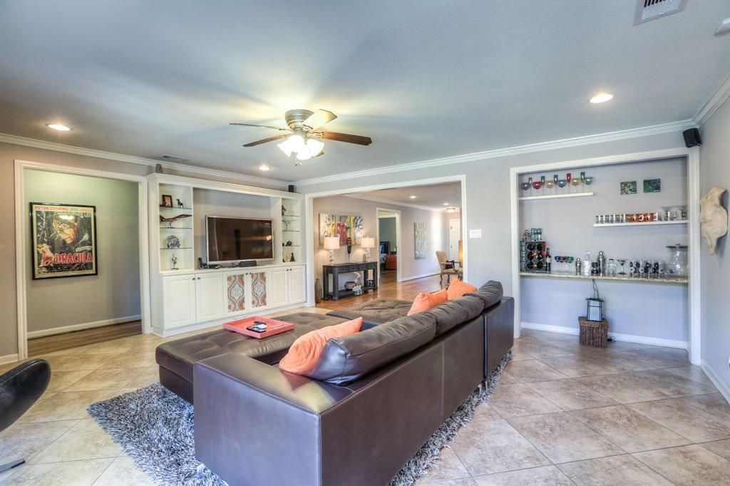 Family room also features built-in storage and crown molding.  Smart home security system and thermostat control compatible with Amazon Alexa.