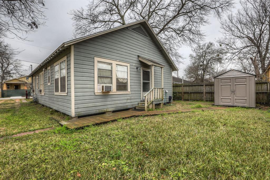 Storage shed located behind the house is perfect for storing lawn equipment or outdoor toys and supplies