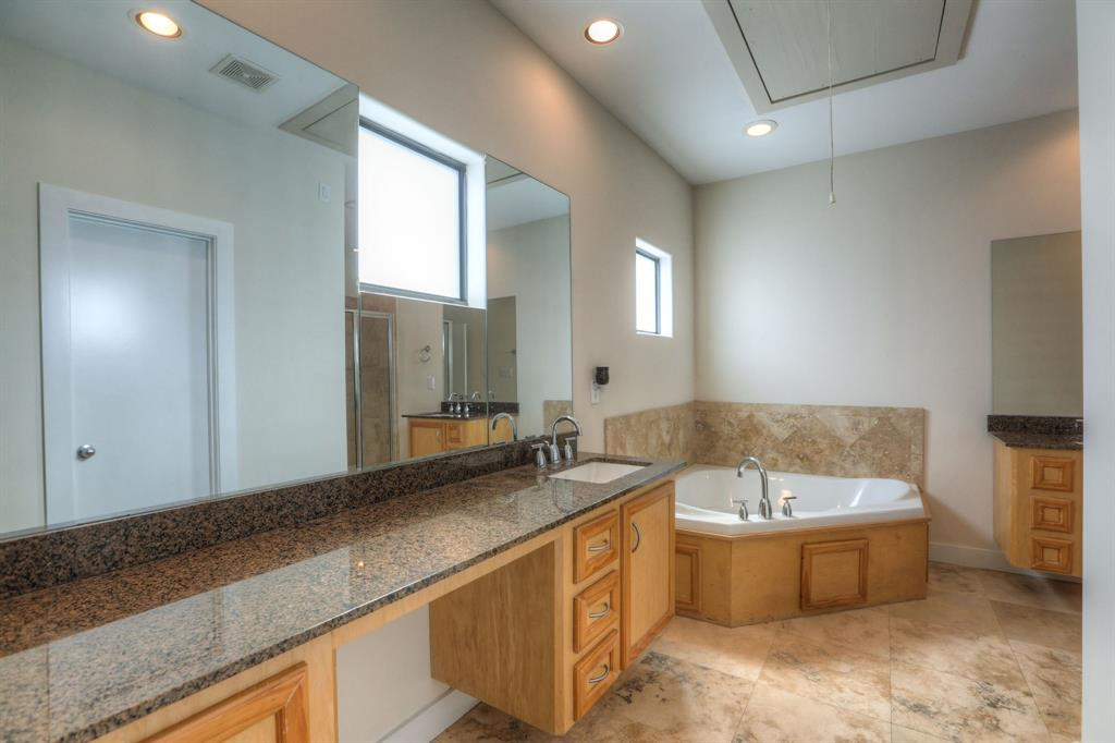 Master Bath features a whirlpool tub, granite counter tops and floating vanity!