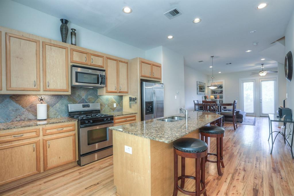 All appliances stay! Open and well lit kitchen featuring granite counter tops and stainless steel appliances.