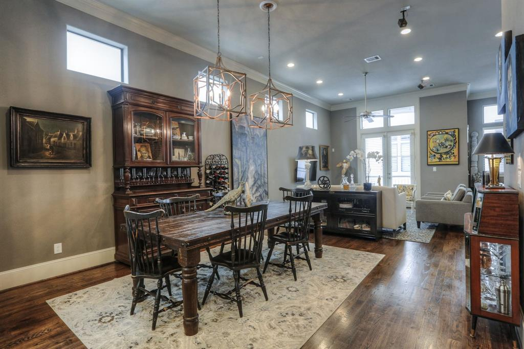 Large dining space that is open to the kitchen and living room features custom selected chandeliers.
