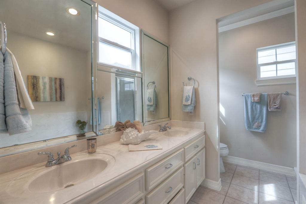 The large master bathroom includes a large vanity with dual sinks. You'll love the natural light that floods this space.