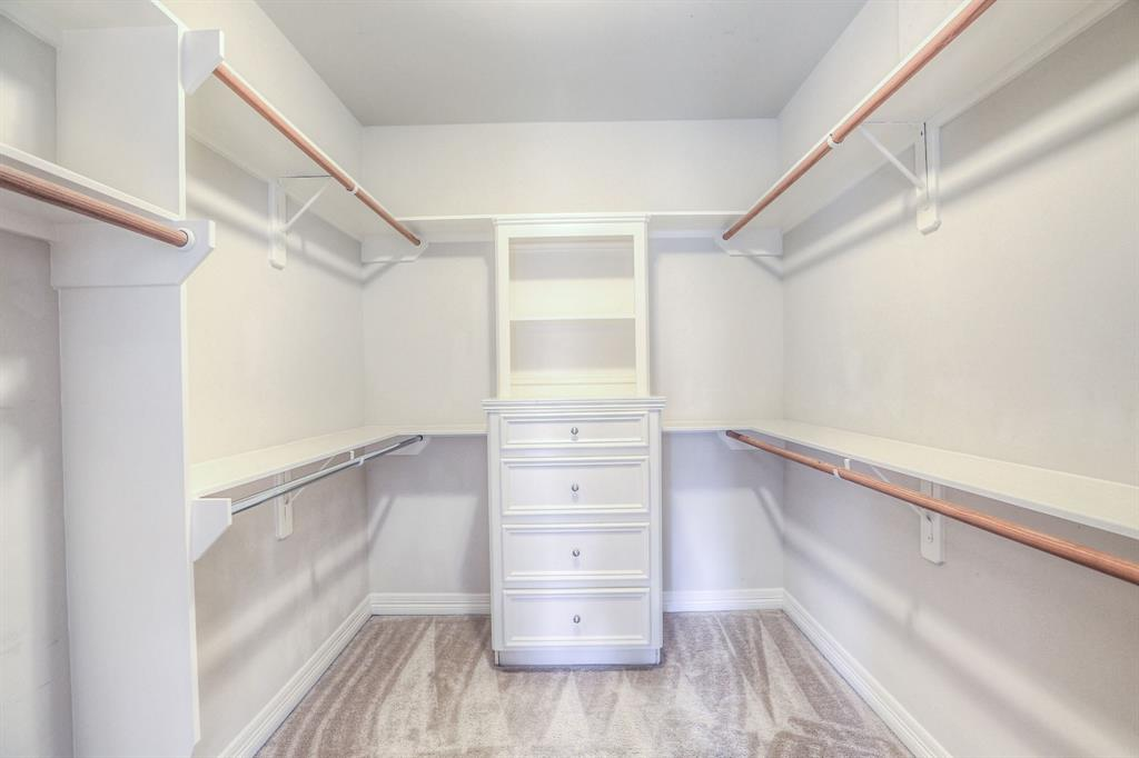 Wow! Check out this huge walk-in master closet.