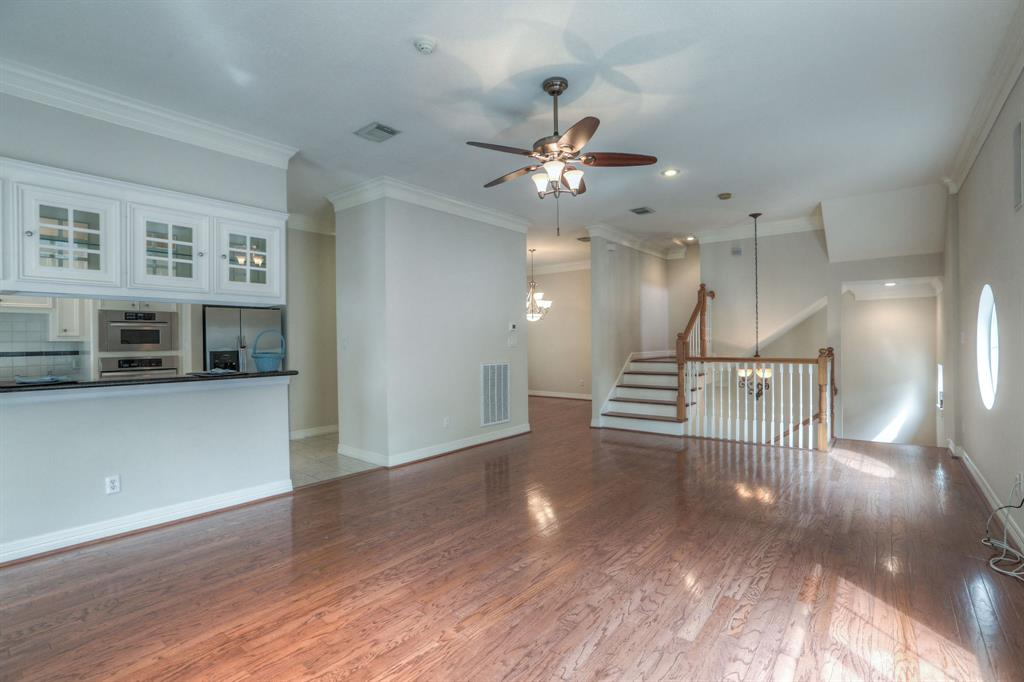 The living space also features hardwood floors and recessed lighting.