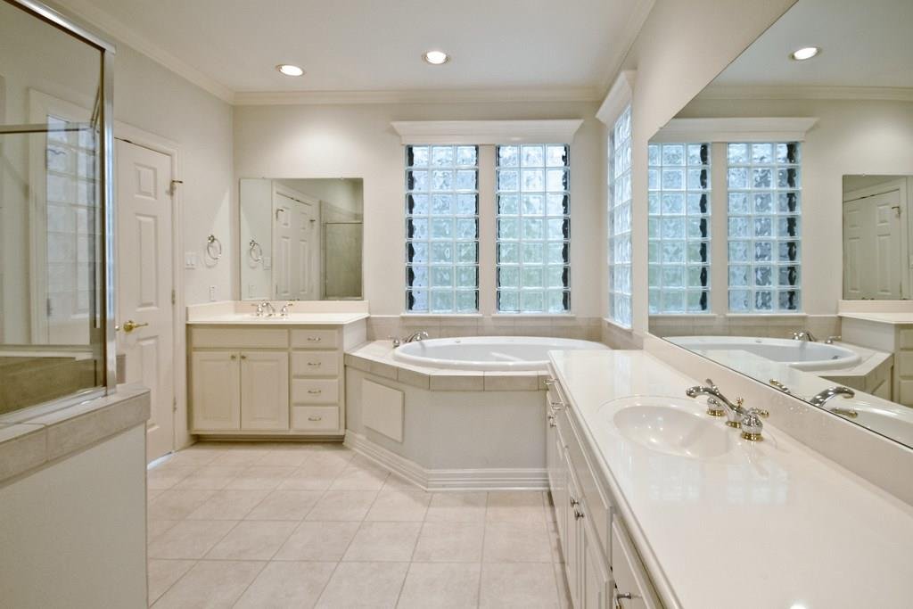 Master bath features dual vanities with separate tub and shower. You'll love starting your day in this open space.