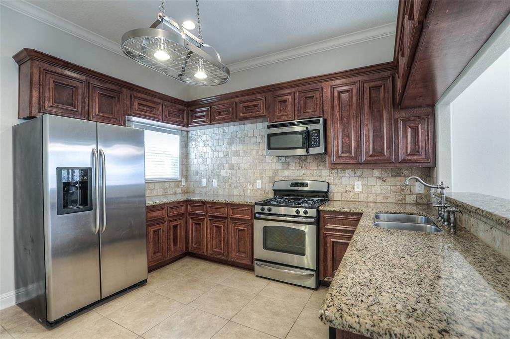 Fully updated kitchen with granite counter tops, stainless steel appliances and stone tile back splash.  Refrigerator included.