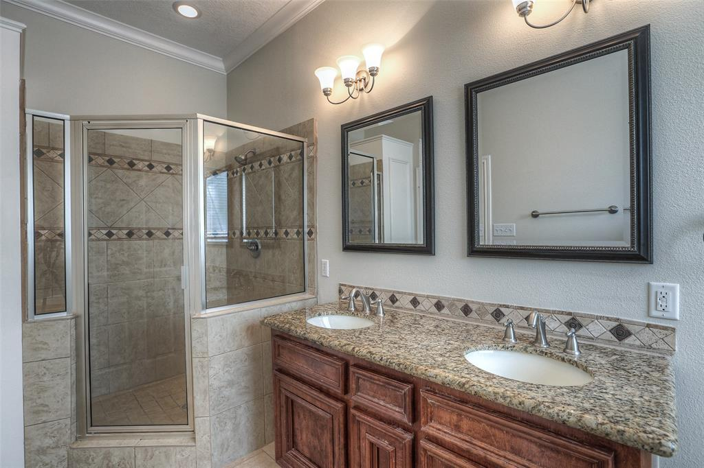 Master bath with dual vanities, granite counter top and tile floor.