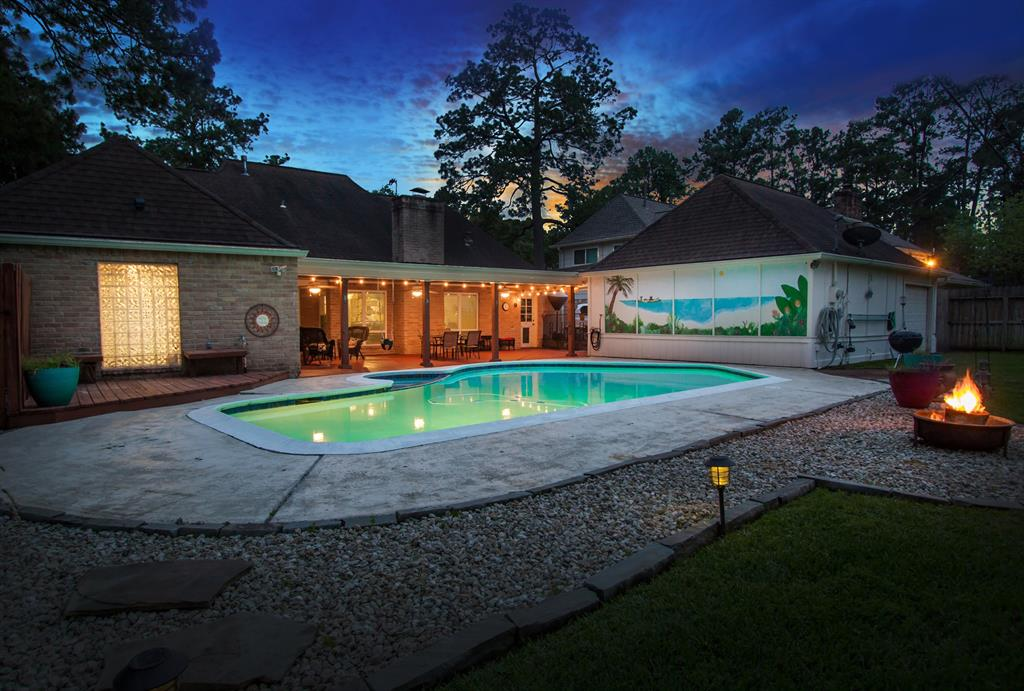 """Truly a rare find! An entertainer's delight 4 bedroom updated custom home on over a 1/2 acre with pool & spa with NO back neighbors in Klein ISD! Natural light exudes throughout this home, features over-sized living & master suite. Boasts soaring ceilings, gorgeous updated windows w/ beautiful views of the backyard oasis, absolutely no carpet, full wet bar, all walk-in closets, & tons of storage! All systems have been upgraded over the past 10 years. Designer kitchen with an abundance of granite counter space & custom cabinetry, sleek cook top, recent KitchenAid stainless steel appliances, under cabinet LED lighting & walk-in pantry. Master features high ceilings, tile plank flooring w/french doors to patio, large master bath w/double sinks, make-up vanity, 5 jetted shower & 2 walk-in closets w/custom """"elfa"""" closet system.Beautifully landscaped w/tons of privacy, wood planked covered patio, full sprinklers system. Easy access to 249, 99, I-45 & Vintage! Excellent Schools!Never flooded!"""