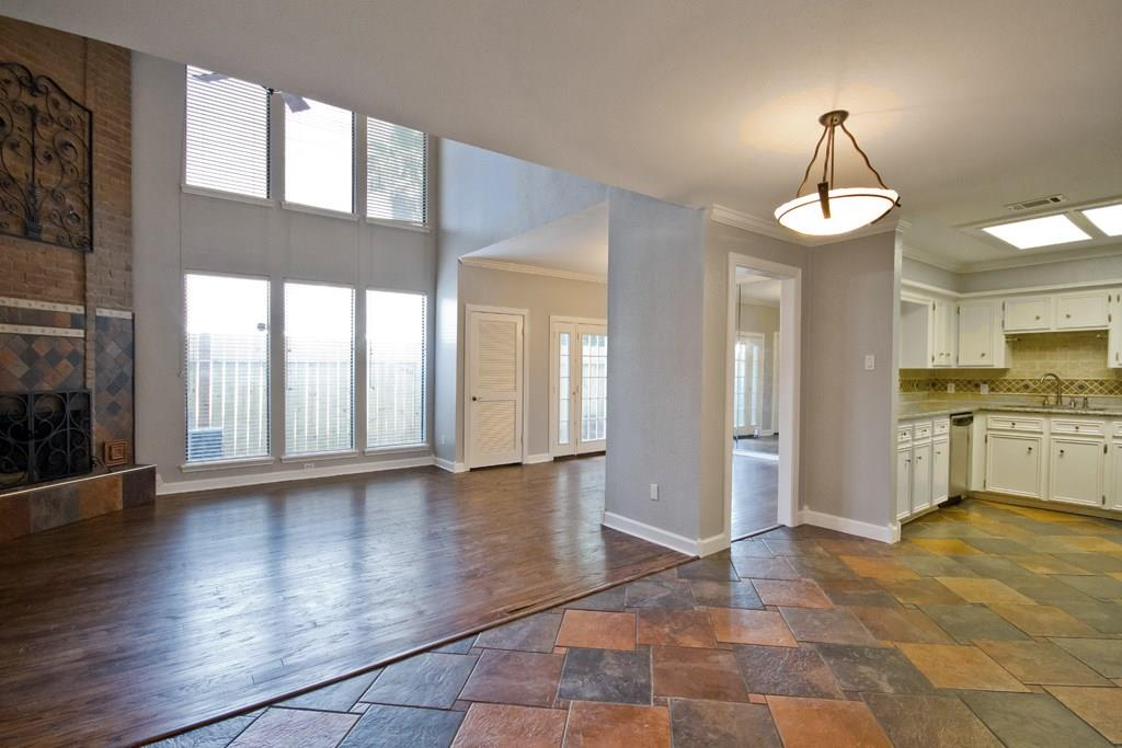 Open floor plan on the first floor with tons of natural light that includes a half bathroom for guests