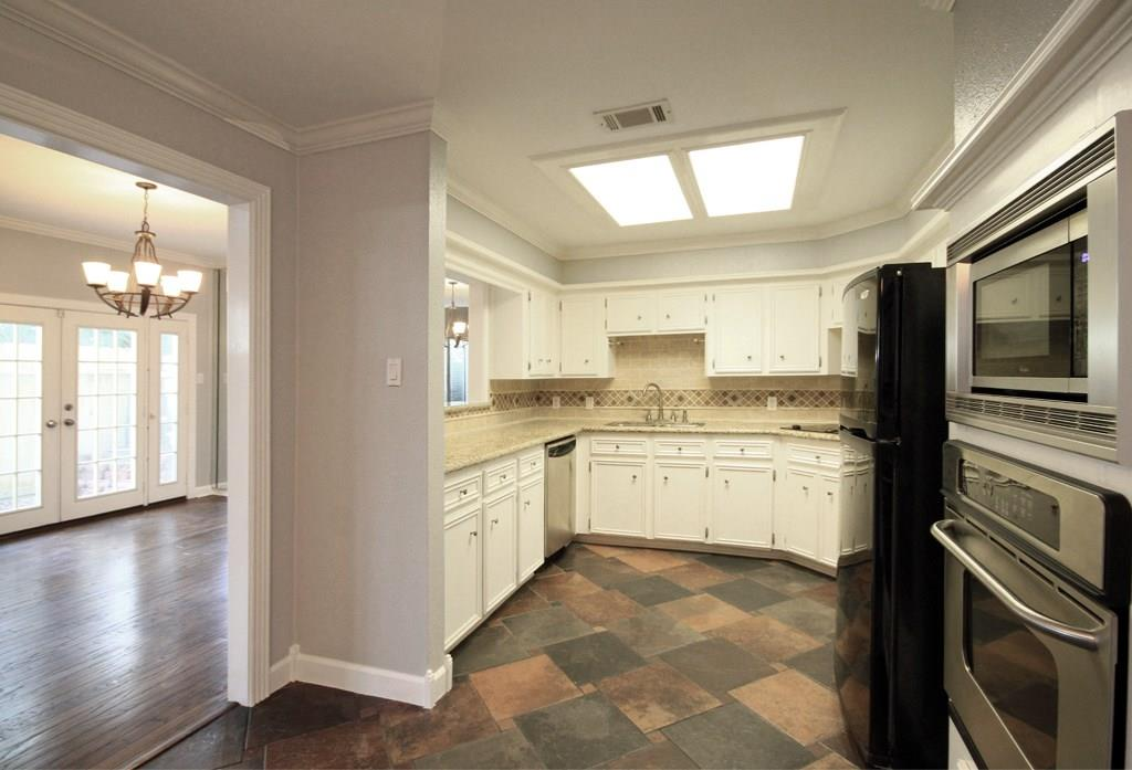 View of the bright kitchen with all appliances included