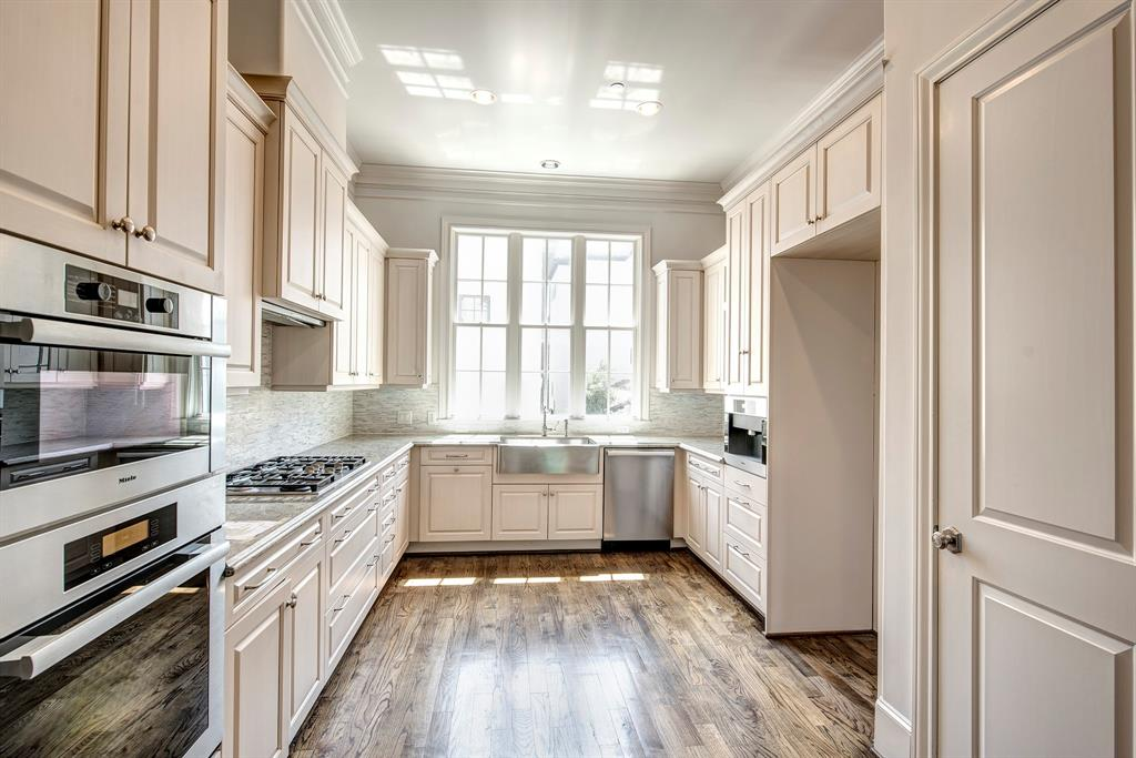 Chef's kitchen with custom cabinetry, Meile Appliances, under counter lighting and tons of storage.