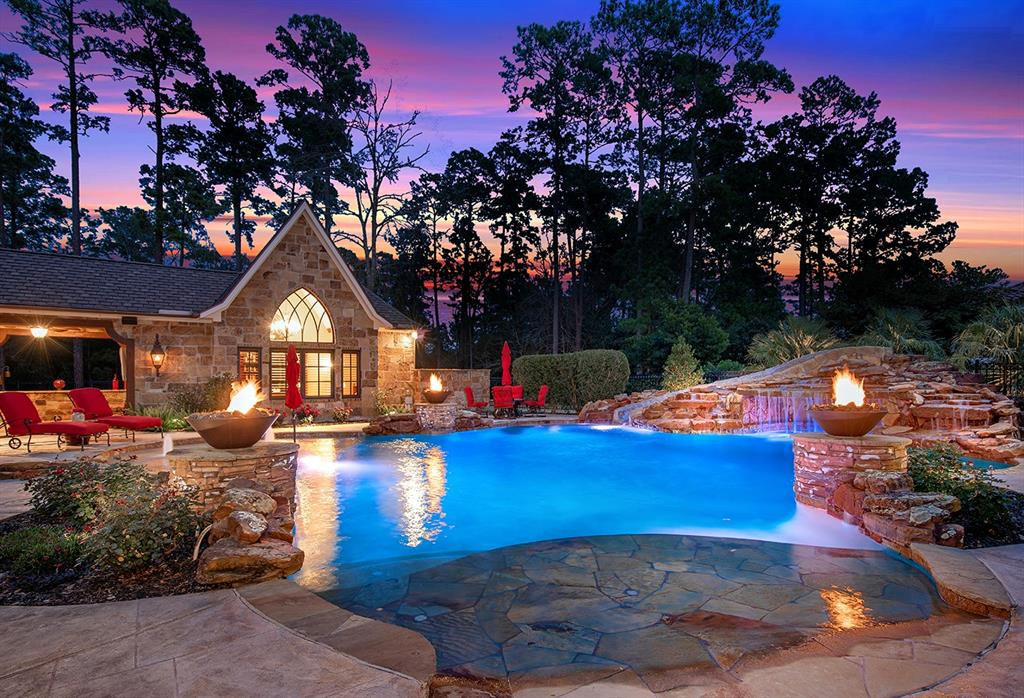 The custom heated pool offers two access areas: one a beach entry.