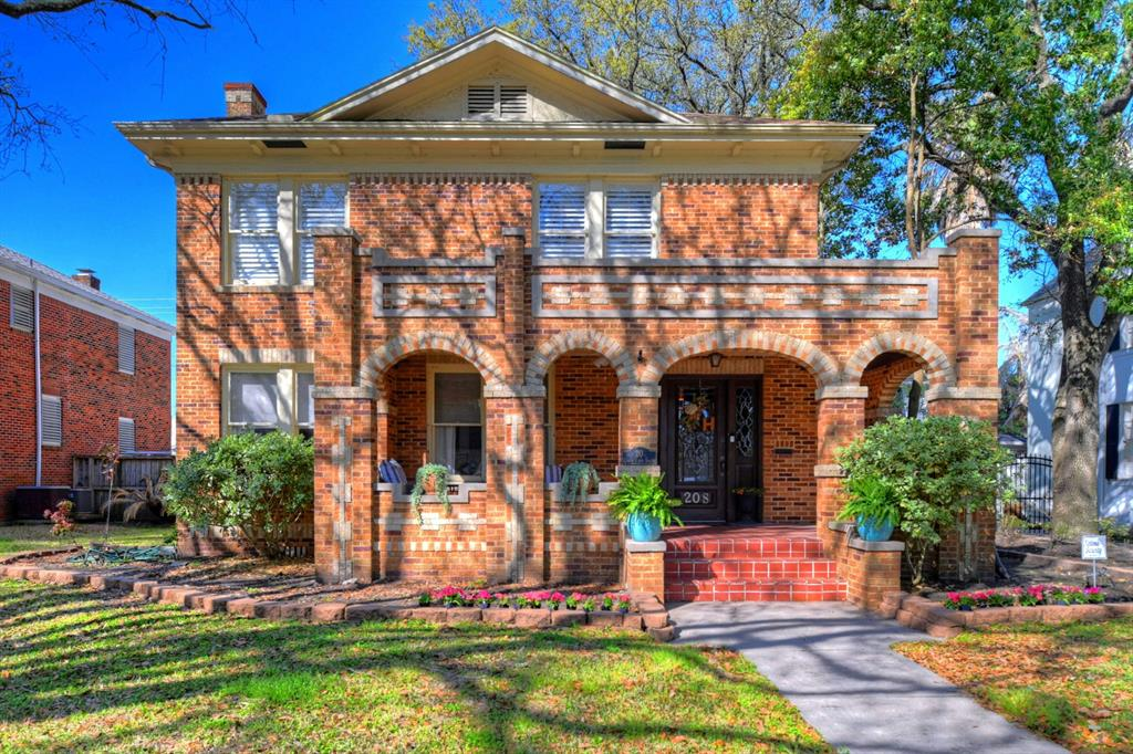 Beautiful Cedar Lawn home with decorative brick, a large, shaded front porch, and plenty of updates.