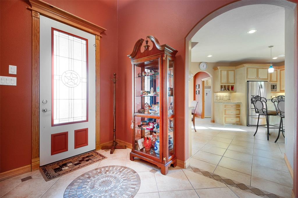 Mosaic tile pattern inlay at front entry, custom transition tile work arched doorways, 5