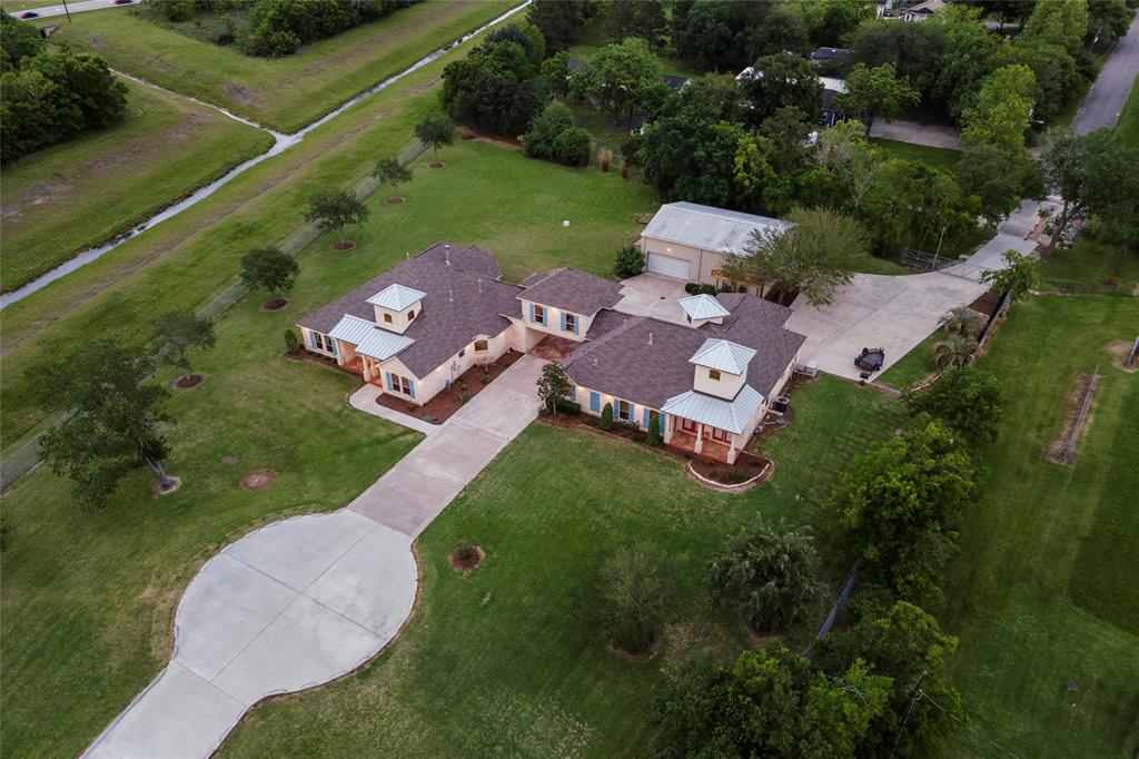 Circular section of the drive provides more than ample parking for family and friends, as well as a turnaround for ease of exiting the property. Clear view of 2nd automatic gated entrance off of Ellen Street at top right of pic.