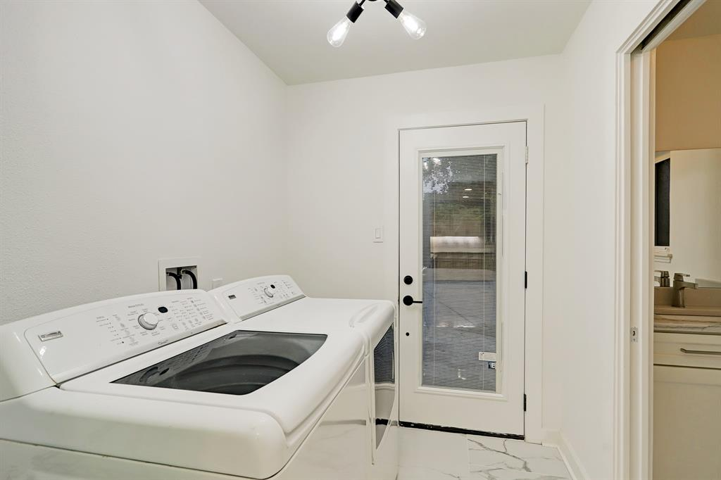 Off the kitchen, a mudroom/laundry room with a side-by-side washer-dryer leads to the vast rear yard.