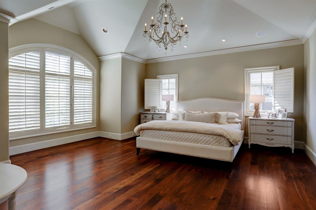 The MASTER BEDROOM (28 X 15) includes wide plank hardwood flooring, sitting area with shuttered windows, crown base molding, built-in speakers, recessed lighting, pitched ceiling and en suite bath and closet.