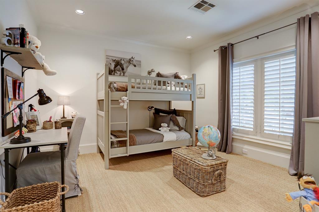 One of three second floor GUEST BEDROOMS - this one (16 X 13) includes shuttered windows, painted walls, carpeted flooring, walk-in closet with shelving and en suite bath.
