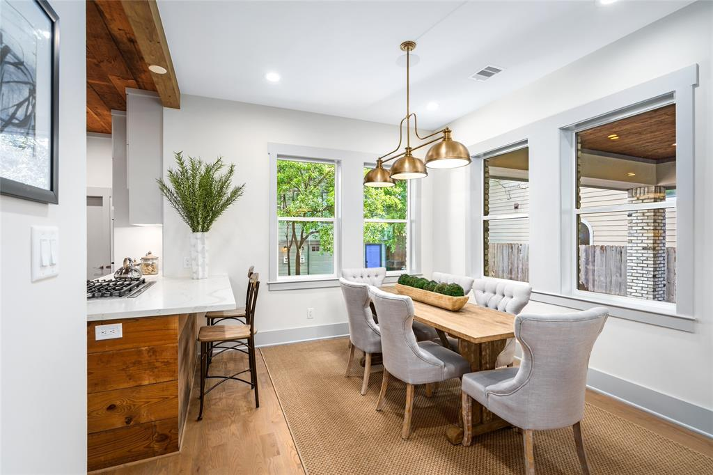 Living room flows into the dining room and is open to the kitchen.  Stove-top island with breakfast bar allows you to host seamlessly without missing a conversation.