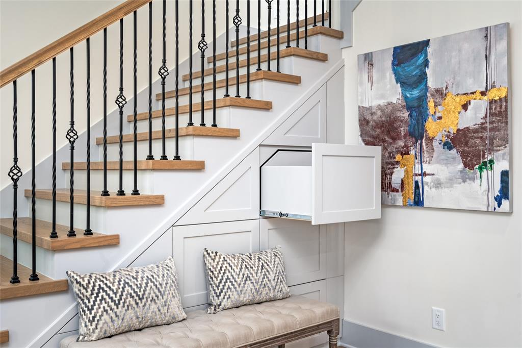 Maximum utilization of negative space.  Push to open under the stairs drawers offers convenient, yet out of sight storage for your everyday needs.