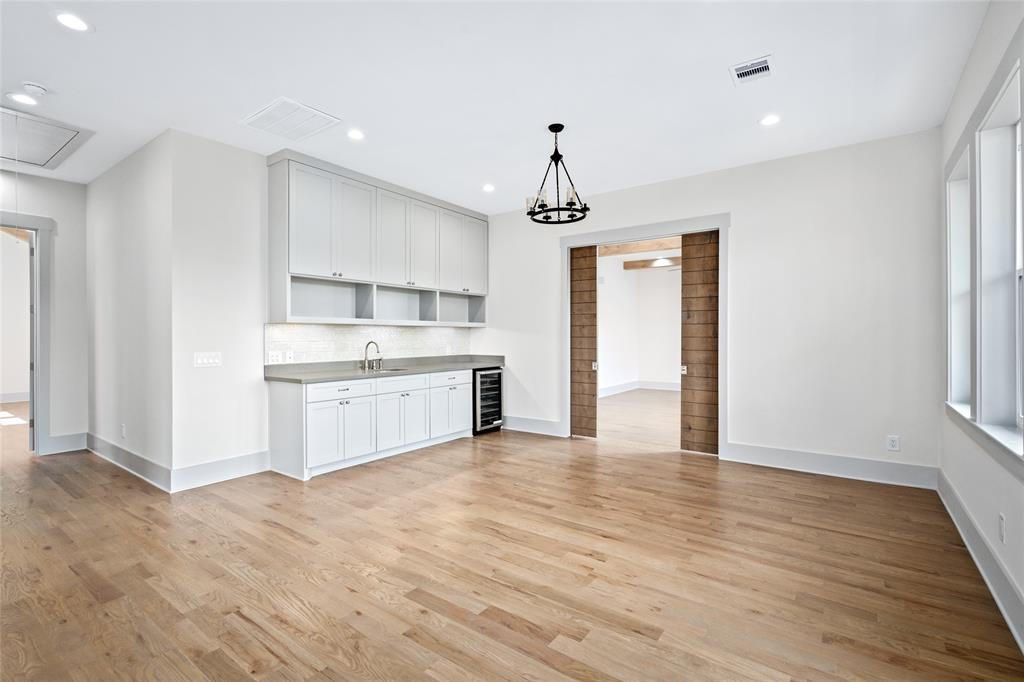 Top floor features a socializing island.  Wet bar fitted with a wine fridge;  Perfect for any mixologist to watch the fireworks outside and ring in the new year with friends and family.