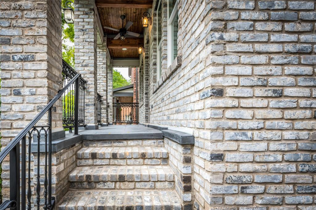 Covered front porch and balconies on every floor offer plenty of outdoor living space.  Ceiling is lined with beautifully reclaimed shiplap.  Come inside and take a look...