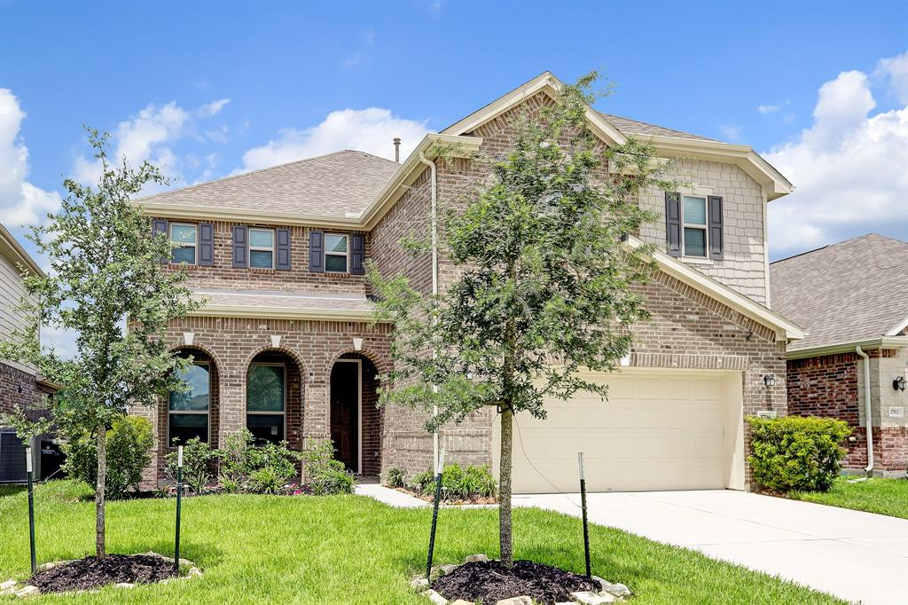 Spacious four bedroom, two and half bathroom with gameroom, formal dining and more!