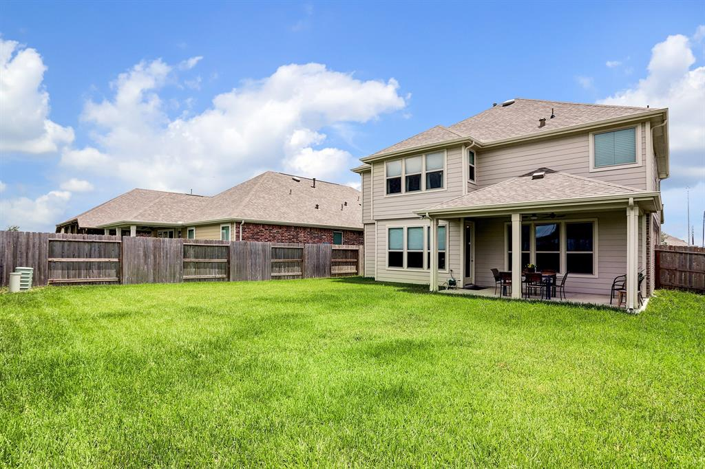 Large lot with green space on back side for added privacy. This amazing home has a full gutter system for proper drainage