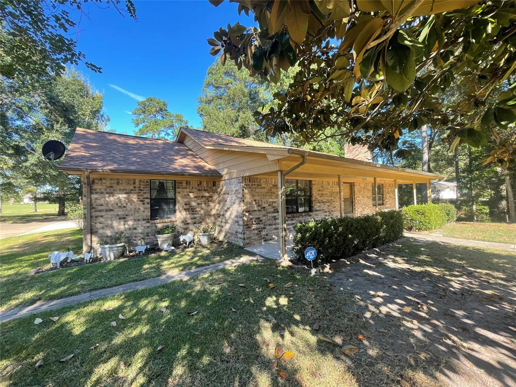 Pristine updated home located on the golf course!  Beautiful large magnolia tree in front yard, double attached garage and large covered carport