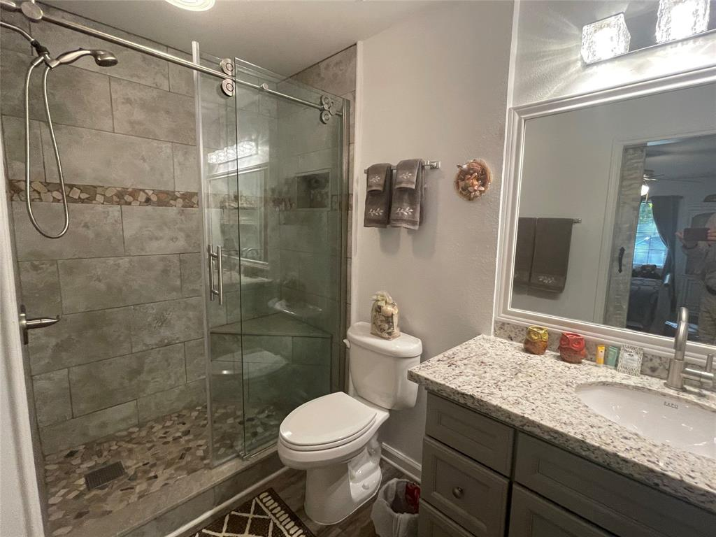 Completely remodeled mast bath with new walk in tiled shower