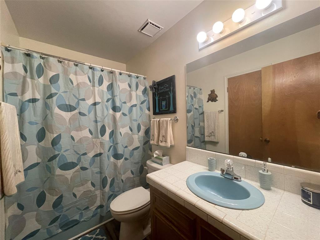 2nd bathroom has shower/tub combo with tiled sink