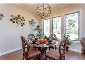 This Informal Dining  Room has a nice view of the out doors. It s just off the kitchen and the living area.