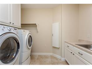 Spacious Utility Room with ample Storage, a Sink and Room to fold your clothes.