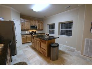 Step into the kitchen!  Nice and open to the living room.  Granite counter tops and a huge amount of cabinets.