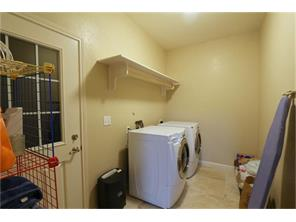 Just off the kitchen you will find the laundry room.  Very spacious with a shelf for all your cleaning supplies and even a clothes rod making laundry day a breeze